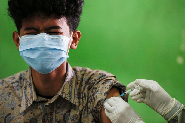 A student receives his first Covid vaccination in Jakarta, Indonesia