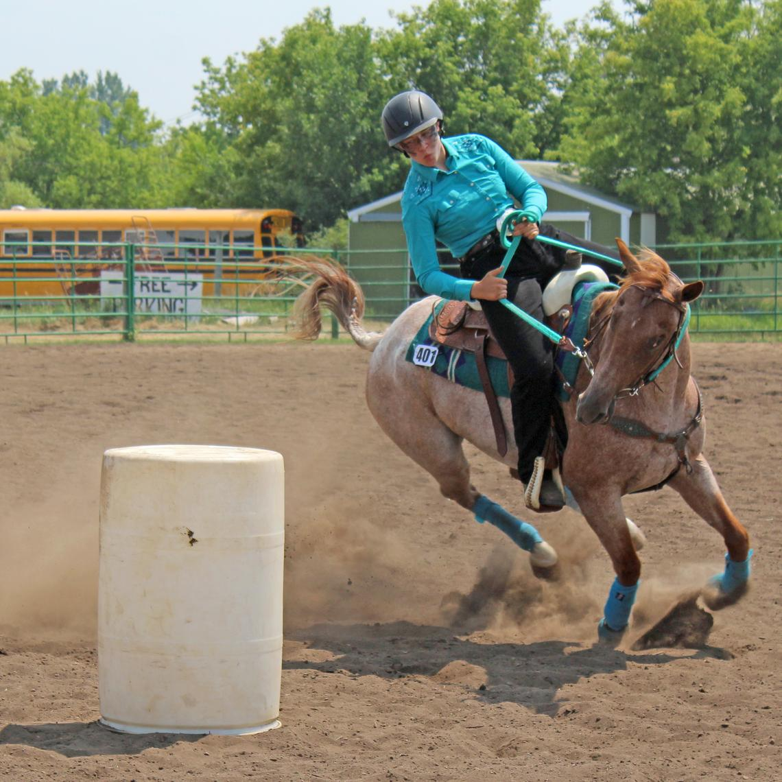 Maggie Kay Carter and her red roan quarter horse Bunny lean hard into a turn during the barrel racing event at the 4-H Riders show Thursday, July 15 at the 2021 Hubbard County Fair. (Robin Fish/Enterprise)