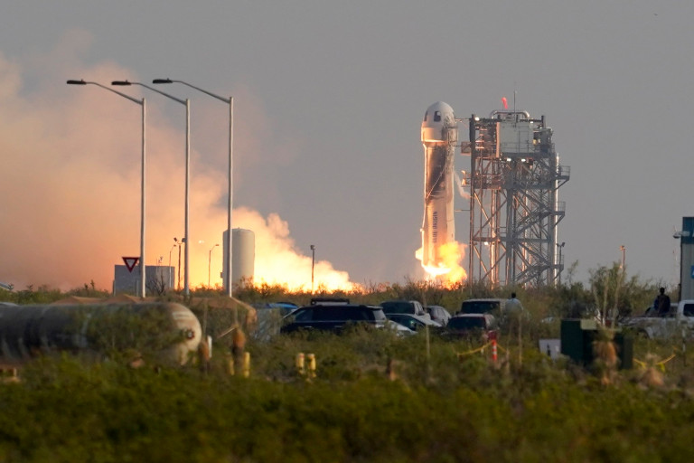 Blue Origin's New Shepard rocket launches carrying passengers Jeff Bezos, founder of Amazon and space tourism company Blue Origin, brother Mark Bezos, Oliver Daemen and Wally Funk, from its spaceport near Van Horn, Texas, Tuesday, July 20, 2021. (AP Photo/Tony Gutierrez)