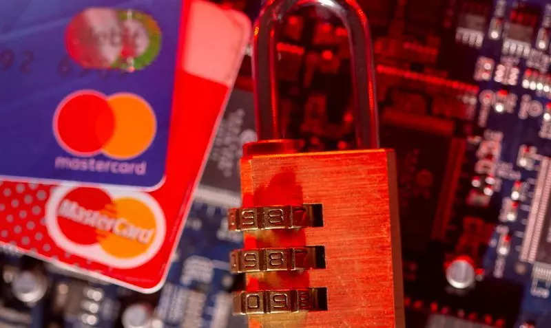 FILE PHOTO: Mastercard credit cards and a padlock on a computer motherboard