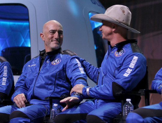 VAN HORN, TEXAS - JULY 20: Members of Blue Origin???s New Shepard crew (L-R) Mark Bezos, and brother Jeff Bezos attend a press conference after flying into space in the Blue Origin New Shepard on July 20, 2021 in Van Horn, Texas. Mr. Bezos and the crew that flew with him were the first human spaceflight for the company. (Photo by Joe Raedle/Getty Images)