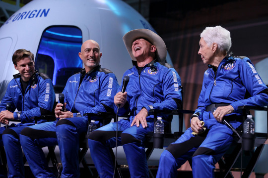 VAN HORN, TEXAS - JULY 20: Blue Origin???s New Shepard crew (L-R) Oliver Daemen, Mark Bezos, Jeff Bezos, and Wally Funk hold a press conference after flying into space in the Blue Origin New Shepard on July 20, 2021 in Van Horn, Texas. Mr. Bezos and the crew that flew with him were the first human spaceflight for the company. (Photo by Joe Raedle/Getty Images)
