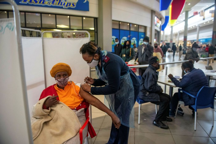 A patient receives a Johnson & Johnson vaccine in South Africa