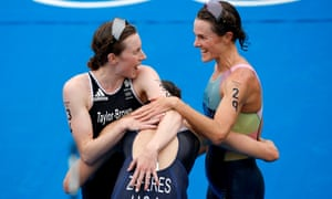 Georgia Taylor-Brown celebrates with her fellow medalists  Katie Zaferes and Flora Duffy after the women's triathlon