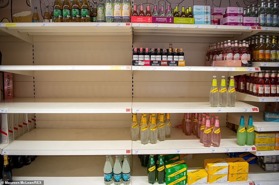 Some customers have been panic buying, leaving some gaps in the shelves (pictured, shelves in Sainsbury's in Taplow, Buckinghamshire). There are some supply chain issues in general with supermarkets due to HGV lorry driver shortages because of the 'pingdemic'