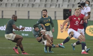 British and Irish Lions' Duhan van der Merwe (right) trips South Africa's Cheslin Kolbe and gets a yellow card.