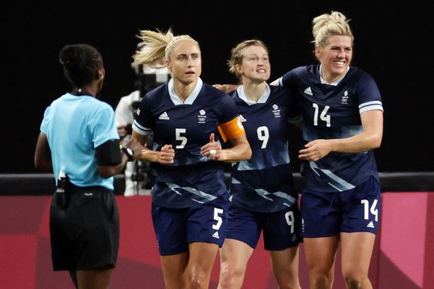 White celebrates her second goal with Steph Houghton and Millie Bright