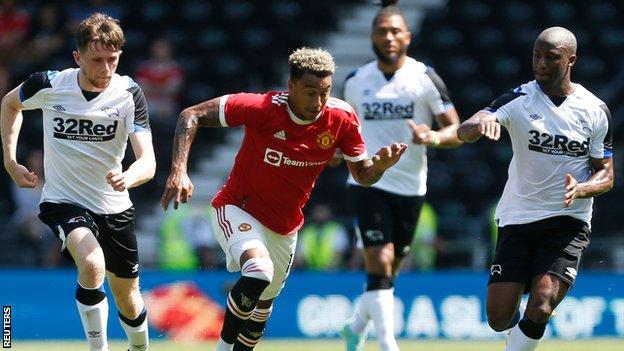 Derby players chase Jesse Lingard