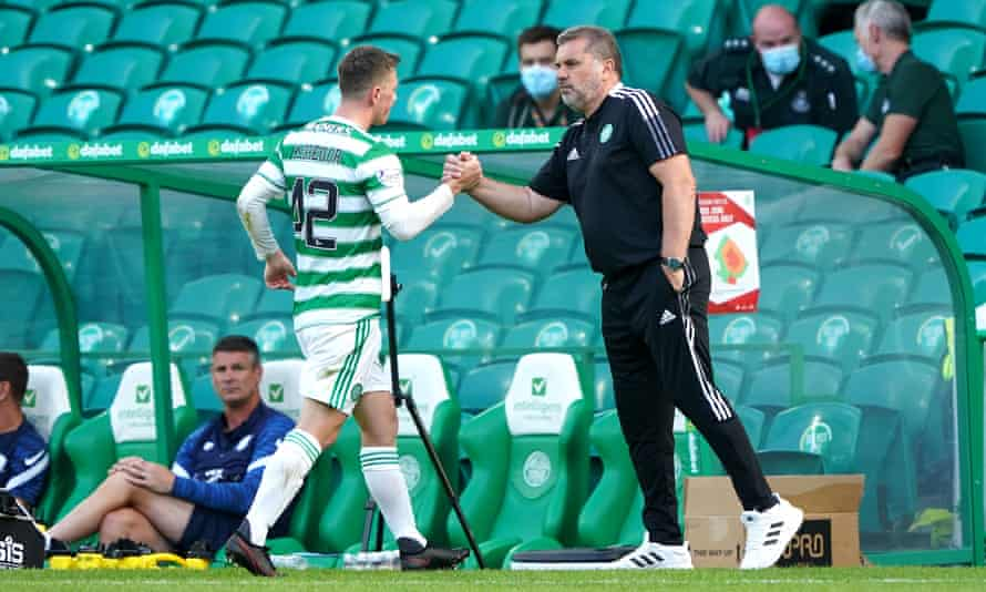 Celtic's manager, Ange Postecoglou, shakes hands with Callum McGregor during the pre-season friendly with Preston at Celtic Park.