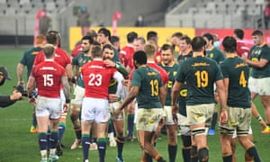 Springbok and British and Irish Lions players congratulate each other at the end of the match.