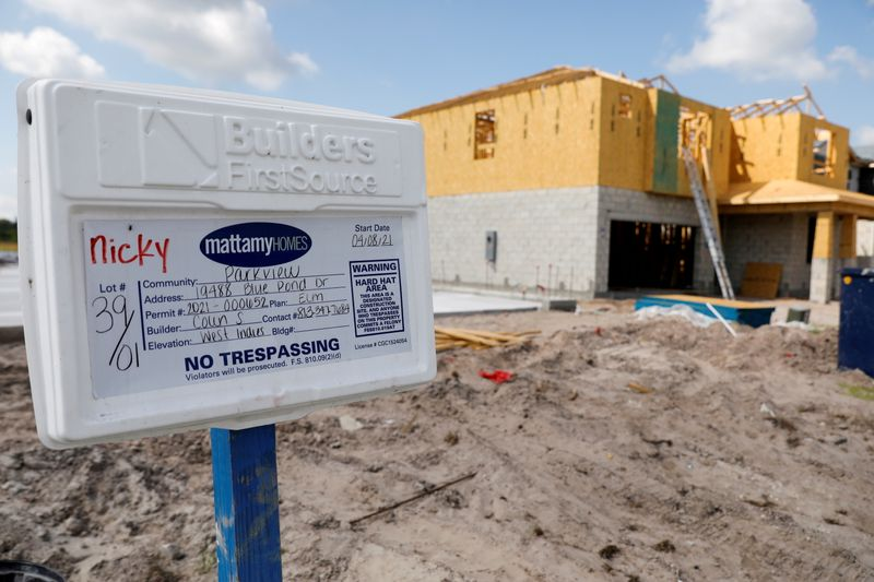 U.S. housing starts accelerate, building permits skid to eight-month low