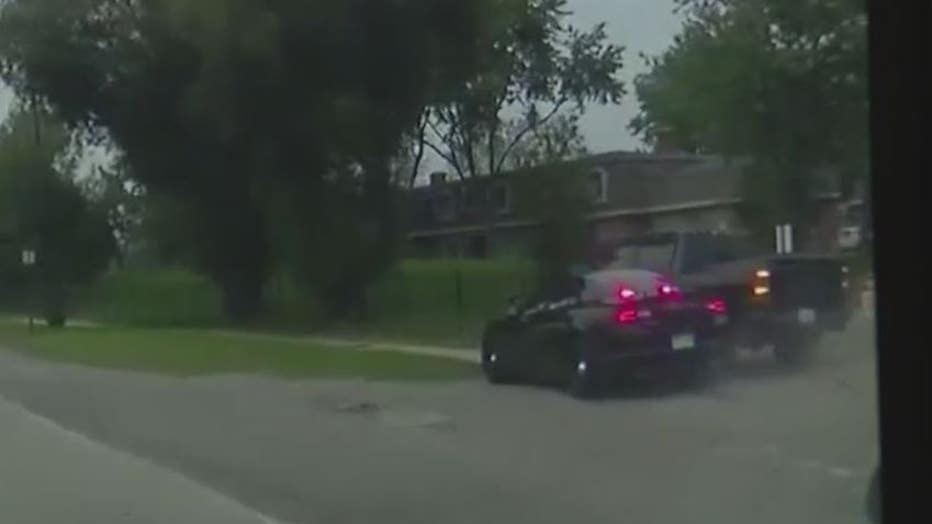 Police video still from the chase and arrest of stolen car suspects in Southfield.