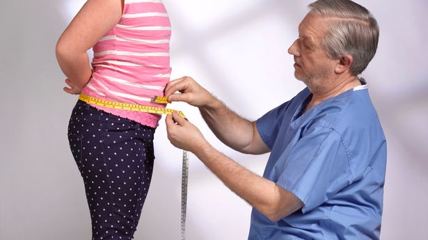 Doctor measuring young girl
