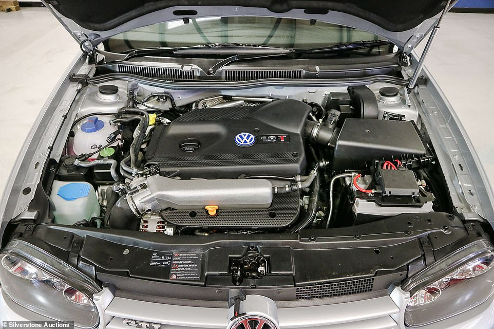 As you might expect from a car that's covered just 8 miles, the engine bay is pristine. The powerplant of a 19-year-old car rarely looks like this
