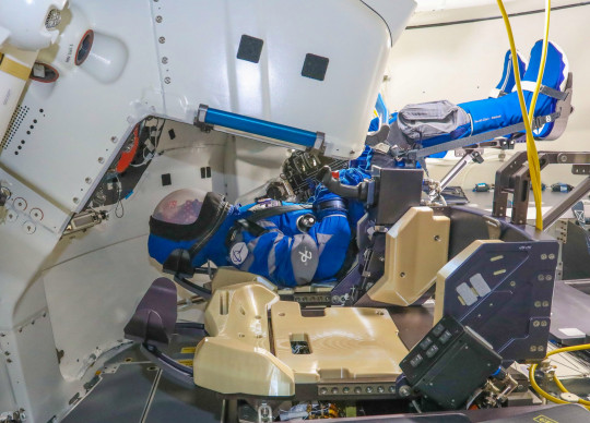 Undated handout photo issued by NASA of dummy pilot Rosie the Rocketeer aboard the Boeing CST-100 Starliner spacecraft. Aerospace giant Boeing is set to attempt its second uncrewed flight to the International Space Station (ISS) as part of a test to show it can get to and from the orbiting lab safely. Issue date: Monday July 26, 2021. PA Photo. See PA story SCIENCE Starliner. Photo credit should read: John Proferes/Boeing/PA Wire NOTE TO EDITORS: This handout photo may only be used in for editorial reporting purposes for the contemporaneous illustration of events, things or the people in the image or facts mentioned in the caption. Reuse of the picture may require further permission from the copyright holder.
