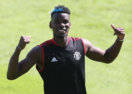 Paul Pogba looks on in Manchester United training
