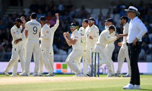 England celebrate the successfully review of the wicket of Cheteshwar Pujara of India.