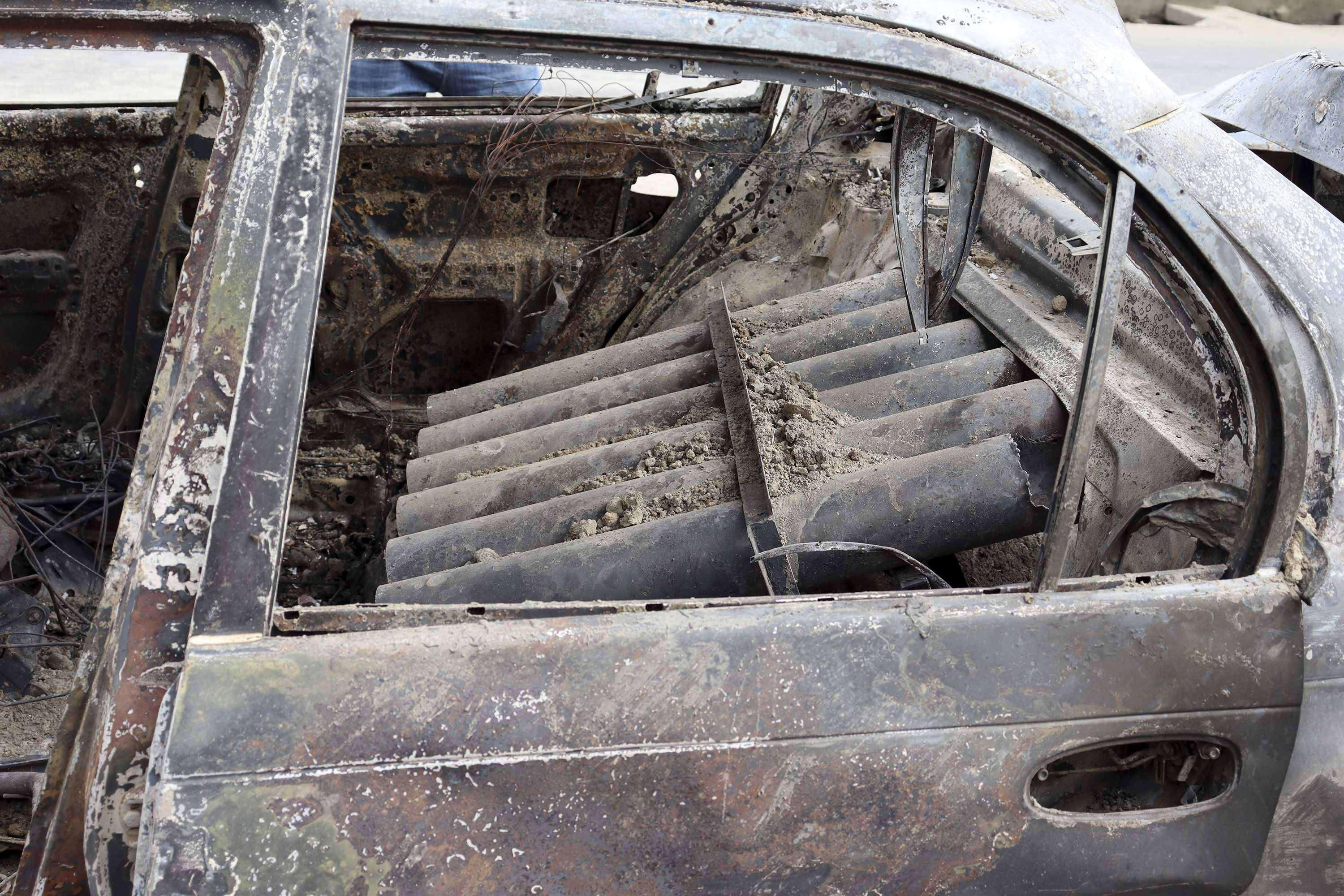 Rocket launcher tubes are seen inside the destroyed vehicle.