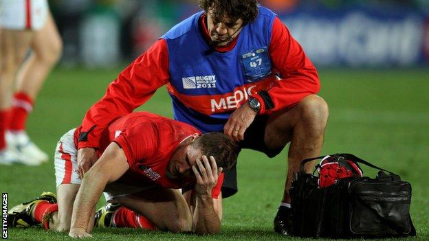 Shane Williams receives treatment for an injury