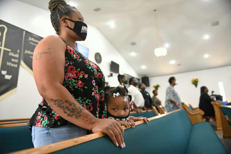 Three-year-old Lyrica Ray and her mother, Sharon Alexander, attend Sunday service at Bethesda Worship and Healing Center in Jonesboro, Arkansas on 8 August 2021.