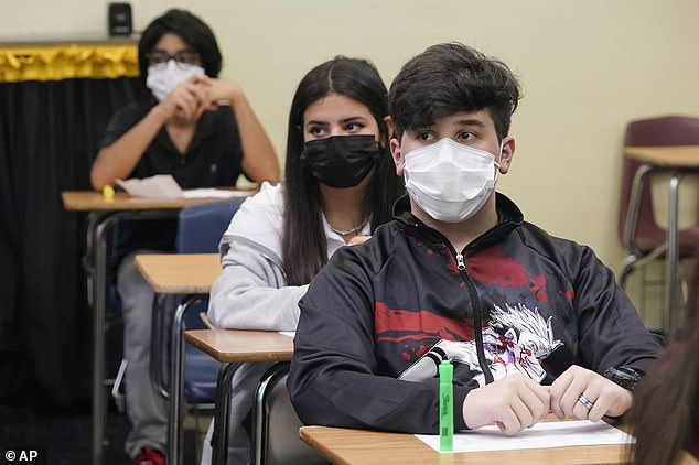 The CDC recommends that all students, teachers, and staff wear masks in school buildings, regardless of vaccination status. Pictured: Masked-up students attend algebra class on the first day of school in Miami Lakes, Florida, August 23, 2021