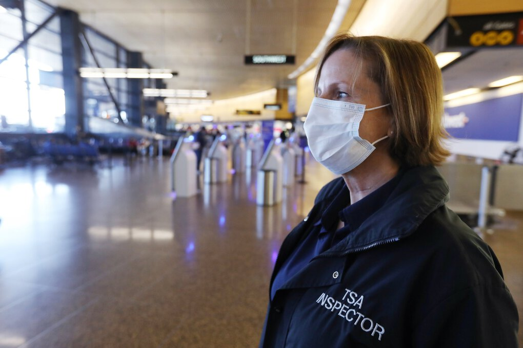 Susan Hegdahl, a transportation security inspector for the Transportation Security Administration based out of the Seattle-Tacoma International Airport, watches airport traffic on Sept. 1. (Ken Lambert / The Seattle Times)