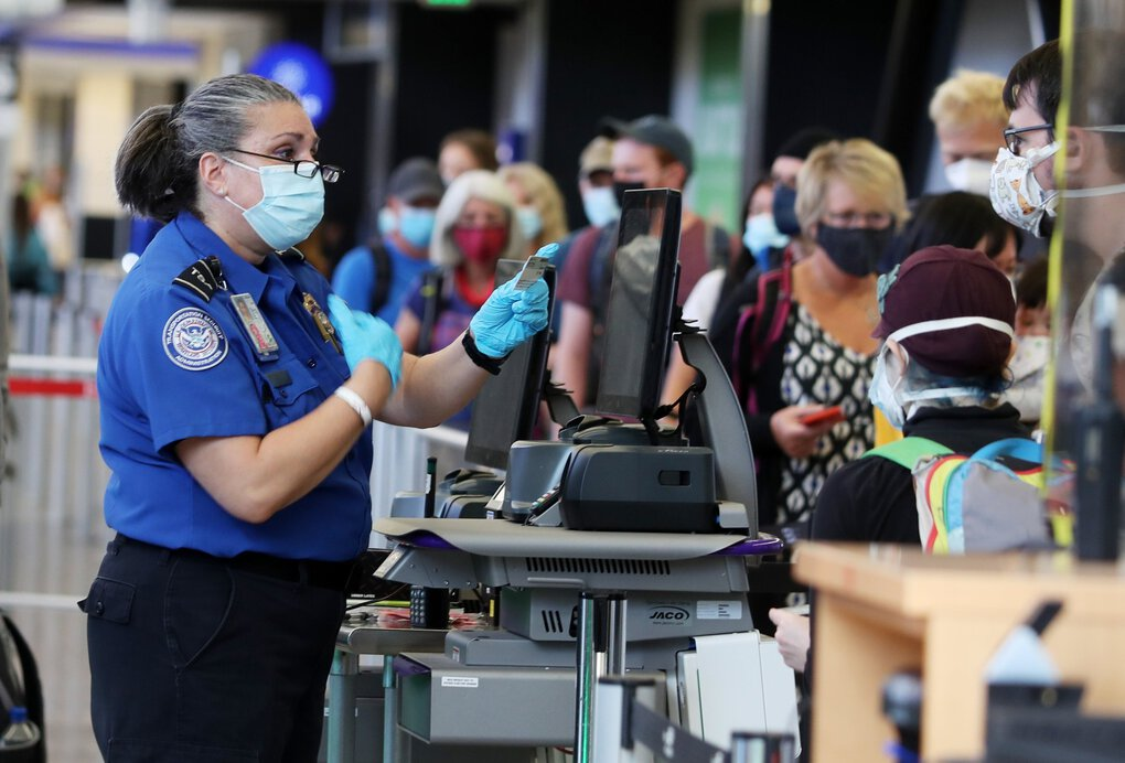 Transportation Security Administration security officer Jacqueline Goldstein checks an ID on Sept. 1 at Seattle-Tacoma International Airport. (Ken Lambert / The Seattle Times)