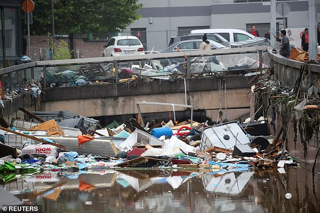 Between 10¿50 per cent of the variation in annual precipitation and temperature in eastern North American and west Europe comes from the jet stream. Pictured: the aftermath of heavy rainfall in Verviers, Belgium, earlier this year. Jet stream changes could make extreme weather events like this a more commonplace phenomenon