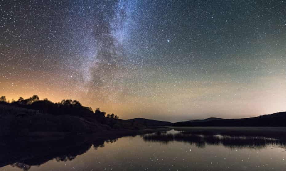 Milky Way and stars over Loch Stroan, Galloway Dark Sky Park, Galloway Forest