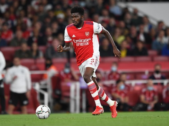 Thomas Partey runs with the ball during Arsenal's Carabao Cup tie with Wimbledon