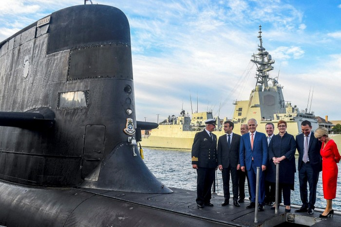mmanuel Macron, second left, and Australian prime minister Malcolm Turnbull, centre, on the deck of HMAS Waller, a Collins-class submarine operated by the Royal Australian Navy, at Garden Island in Sydney in May 2018