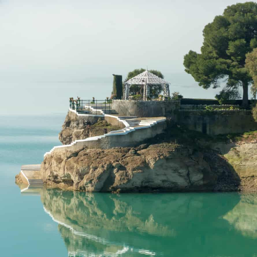 Lakeside House of the Engineer (Casa del Ingeniero) on the turquoise waters of the Embalse del Conde de Guadalhorce, Spain.