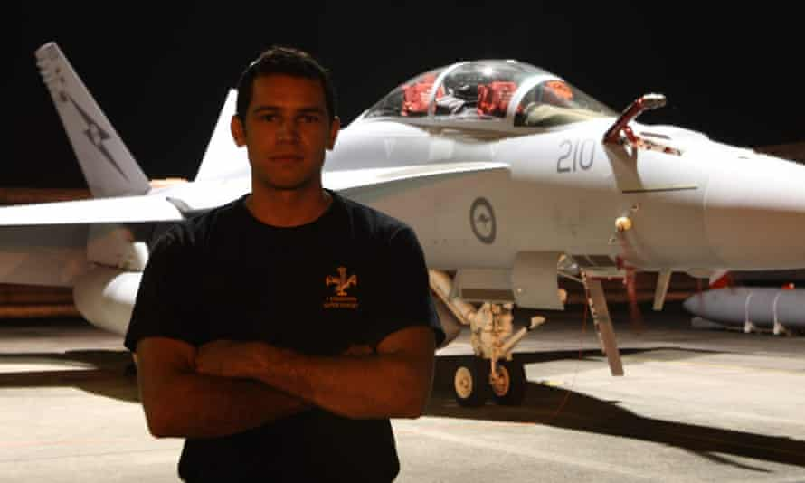 Michael Raymond stands in front of an air force plane