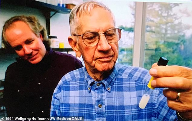 Deadly:Edward Schantz and his former assistant Eric Johnson in 1994 with a vial of undiluted botulinum toxin – enough for tens of thousands of lethal doses