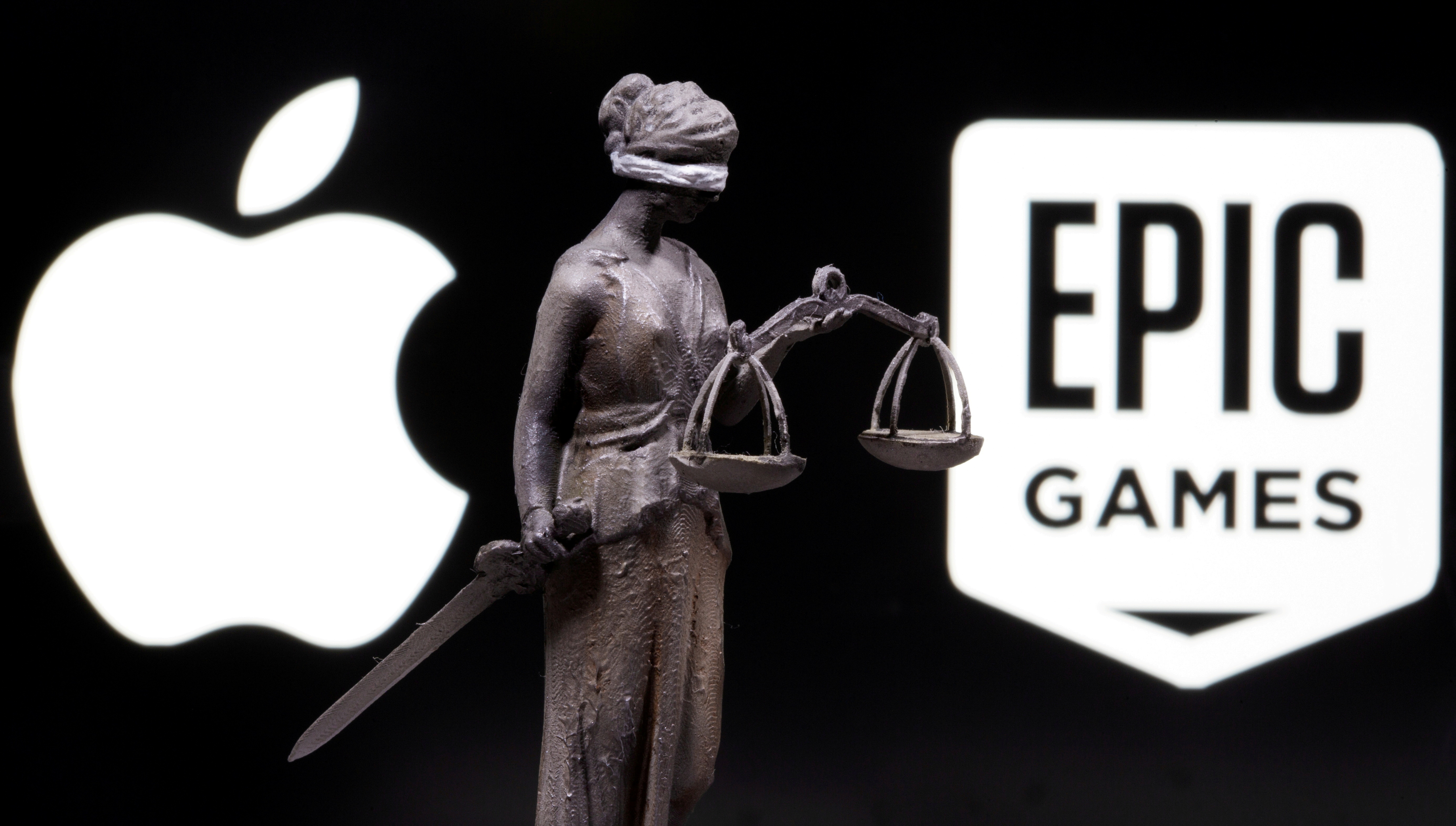 3D printed Lady Justice figure is seen in front of displayed Apple and Epic Games logos in this illustration photo taken February 17, 2021. REUTERS/Dado Ruvic/Illustration/File Photo