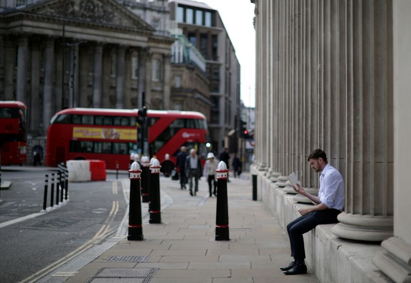 BOE holds rates but two policymakers vote for early stimulus end