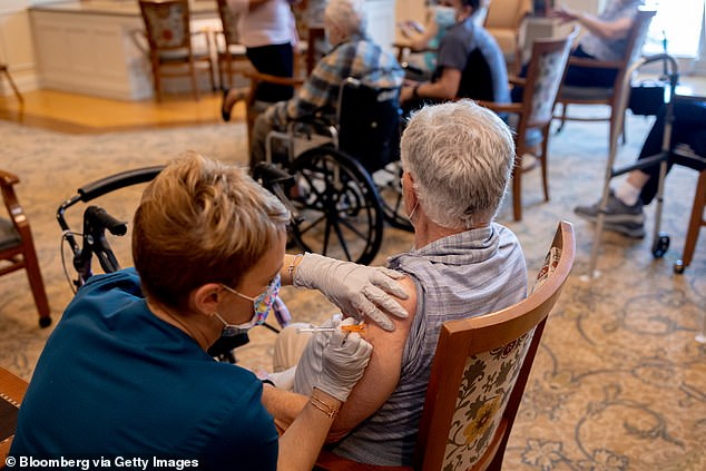 The CDC's Advisory Committee on Immunization Practices voted on Thursday to recommend boosters for those aged 65 and older, long-term care facility residents and those at high risk of severe Covid due to underlying conditions. Pictured: A healthcare worker administers a third dose of the Pfizer vaccine at a senior living facility in Worcester, Pennsylvania, August 2021