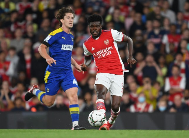 Thomas Partey passes the ball during Arsenal's Carabao Cup clash with AFC Wimbledon