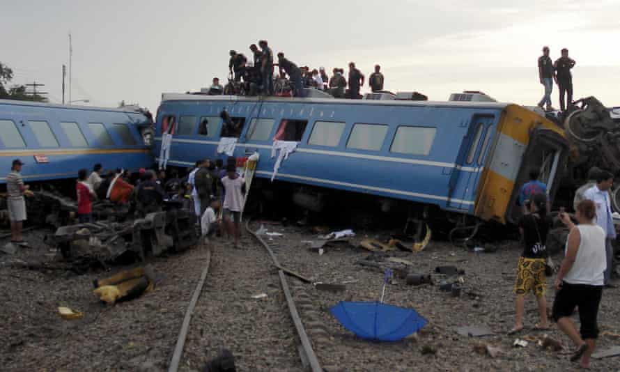 Rescuers on the derailed train carriages in Hua Hin.