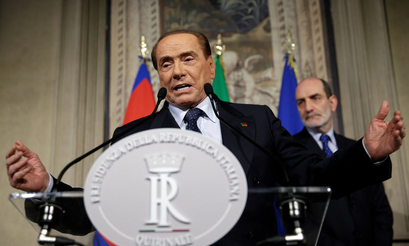 © Reuters. FILE PHOTO - Forza Italia leader Berlusconi speaks following a talk with Italian President Sergio Mattarella at the Quirinale palace in Rome