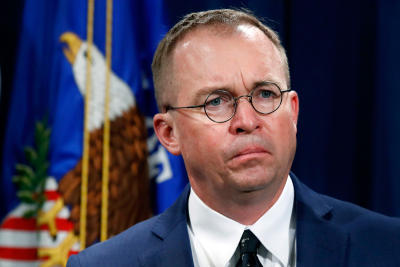 Mick Mulvaney listens during a July 11, 2018, news conference at the Department of Justice in Washington. Mulvaney, now serving as the acting White House