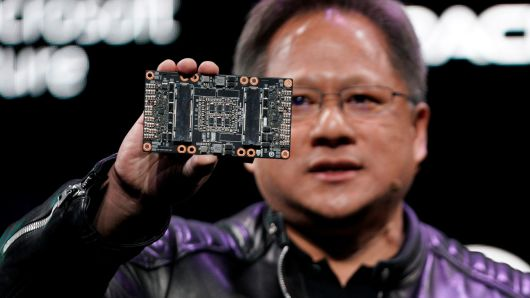 Jensen Huang, CEO of Nvidia, shows the NVIDIA Volta GPU computing platform at his keynote address at CES in Las Vegas, January 7, 2018.