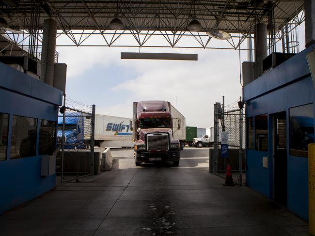 © Bloomberg. Truck drivers wait to speak to a U.S. Customs and Border Protection officer soon after arriving in the U.S. from Mexico at the Otay Mesa Port of Entry cargo facility in San Diego, California. Photographer: Sam Hodgson/Bloomberg