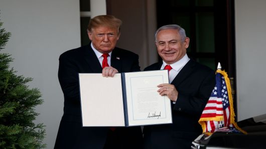 President Donald Trump L and Israeli Prime Minister Benjamin Netanyahu display the proclamation recognizing Israel's sovereignty over the disputed Golan Heights at the White House in Washington D.C., the United States, on March 25, 2019.