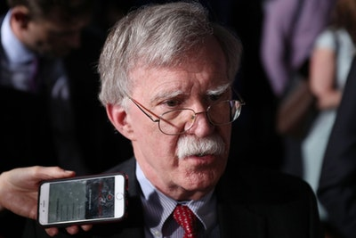 National Security Adviser John Bolton speaks to the media before the arrival of President Donald Trump during a rally Feb. 18 at Florida International University in Miami.