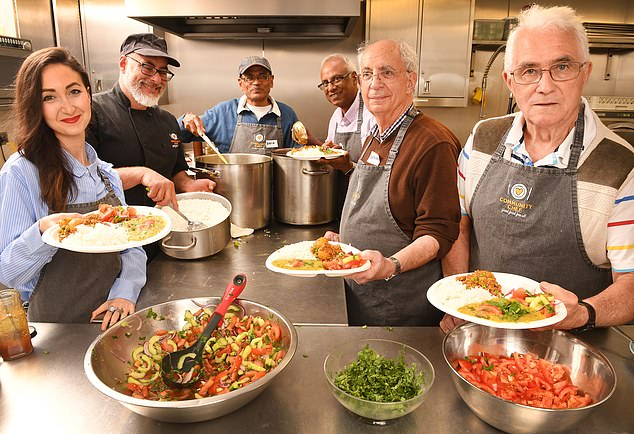 Reporter Eve Simmons joined the men cooking and helped serve the finished meal. She is pictured alongside (from right) Norman Thompson, Edward , Hemant Patel, Deva Patel and chef Robin Van Creveld