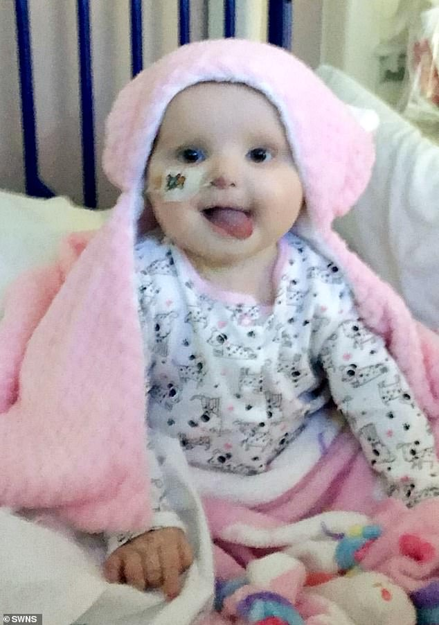 Phoebe, pictured inBirmingham Children Hospital, was diagnosed with cancer after she was vomiting and had a high temperature