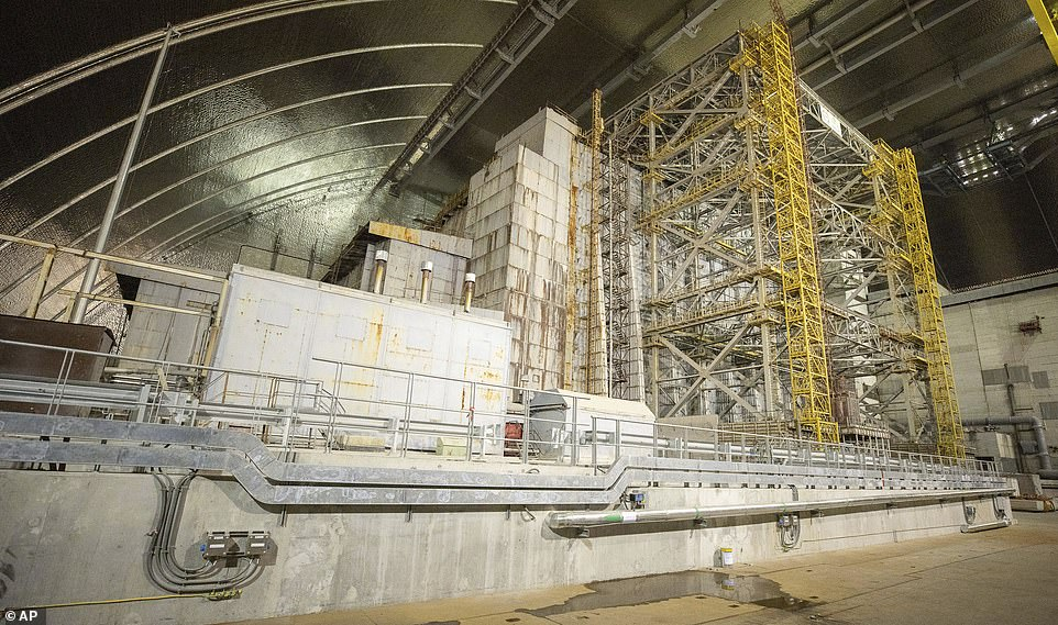 Officials have described the new shelter as the largest moveable land-based structure ever built, with a span of 257 metres and a total weight of over 36,000 metric tons. Pictured: Inside the new structure