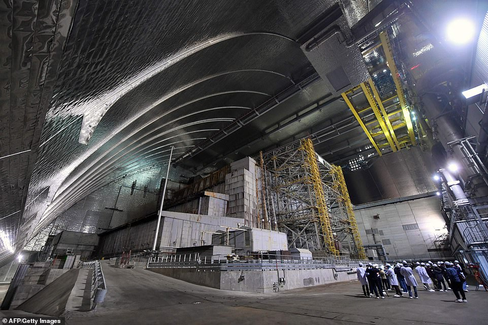 A £2 billion ($2.4bn) replacement to the original sarcophagus, which took nine years to build, was unveiled in July. Pictured: An interior view of theNew Safe Confinement metal dome that now shields the world from any radiation left within the site of the disaster