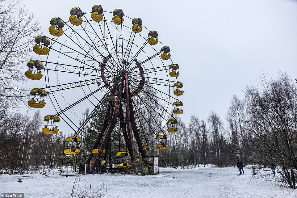 More than 160,000 residents of Pripyat and surrounding areas had to be evacuated and have been unable to return, since the disaster. Pictured: One of Pripyat's most recognisable landmarks is the Ferris wheel. The ride was due to be opened on May 1986 but it never had the chance as the reactor exploded the month before